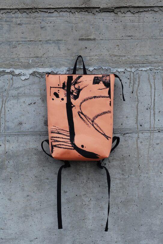 handprinted orange backpack GREI